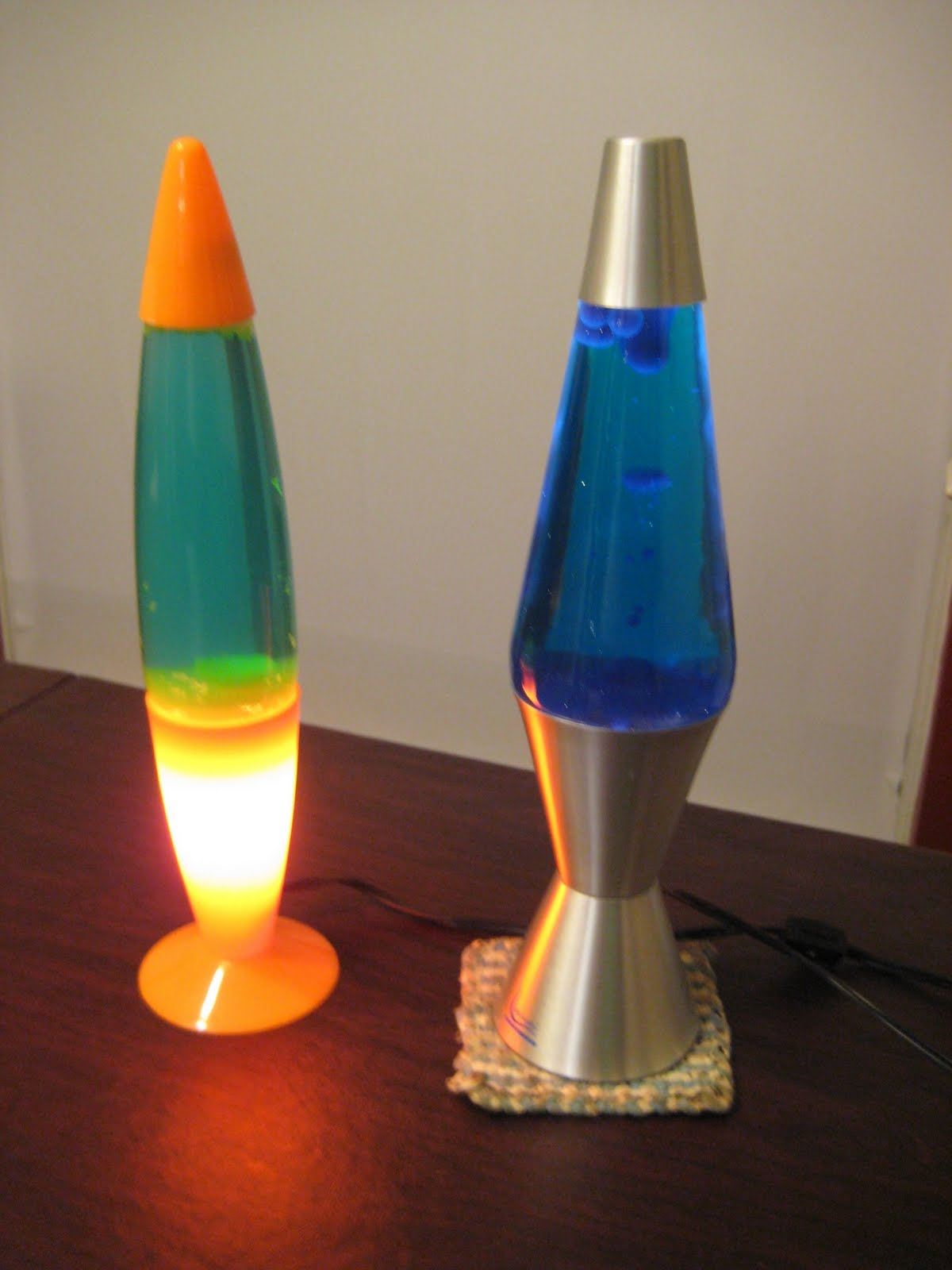 Here Are Two Lava Lamps In Our Vast Collection. One Works Pretty Good,  Except It Was Burning A Hole In The Table.