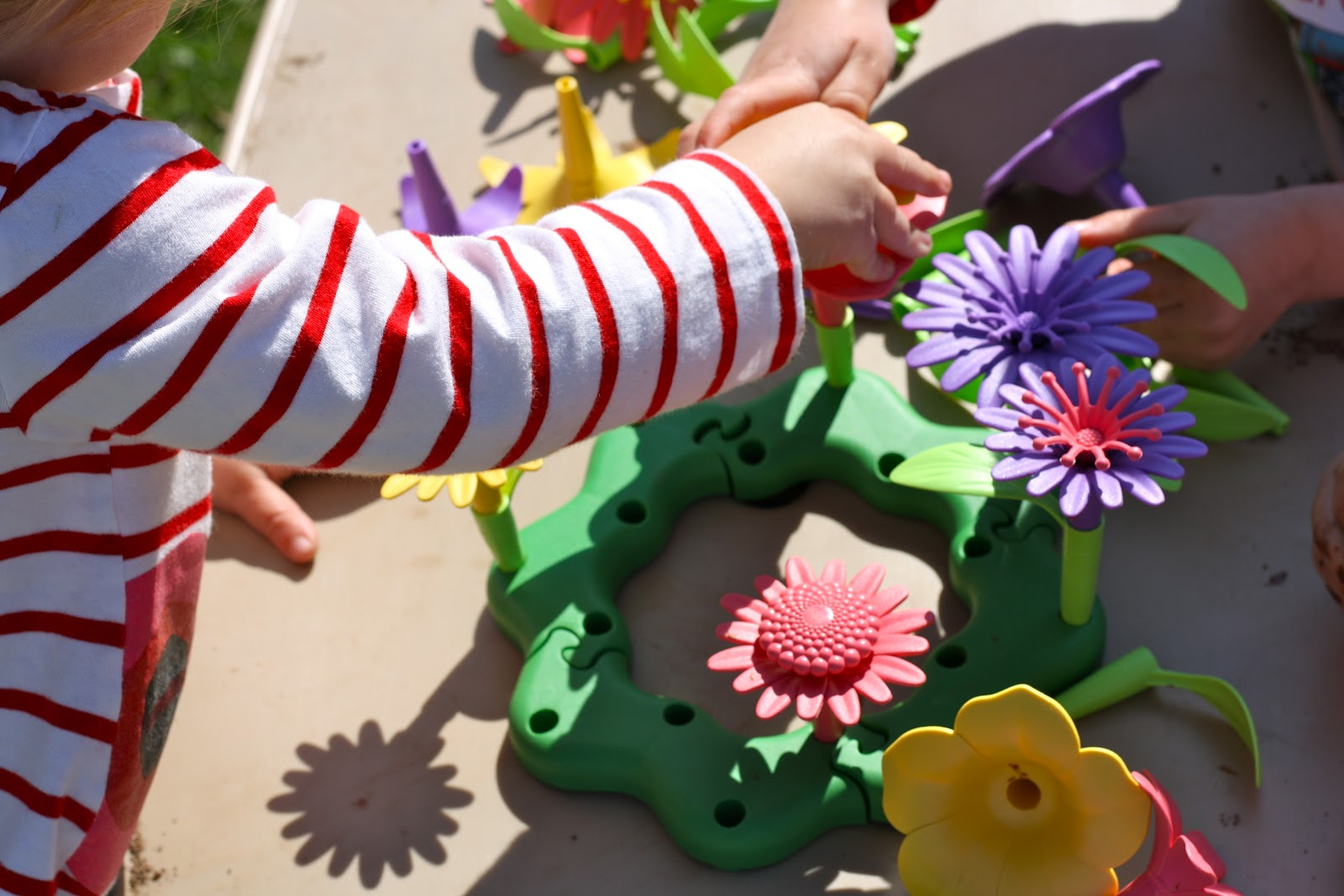The Kids Enjoyed Taking Some Time To Sit Down At Picnic Table Build A Bouquet This Awesome Toy From Green Toys Is Hit In Our House