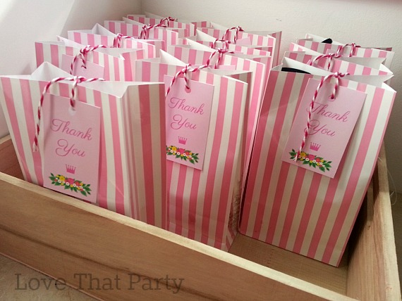 Image of pink stripes paper party bags with princess party thany you tags and pink baker's twine