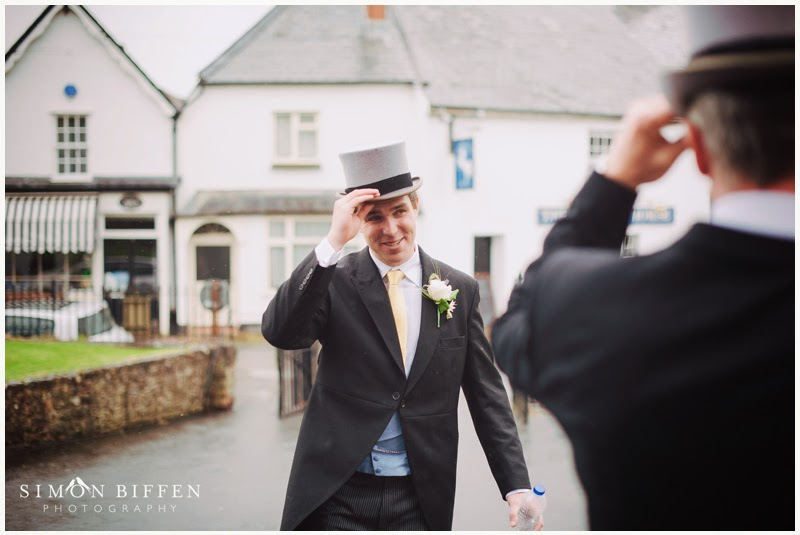 Groom in top hat and tails at the church