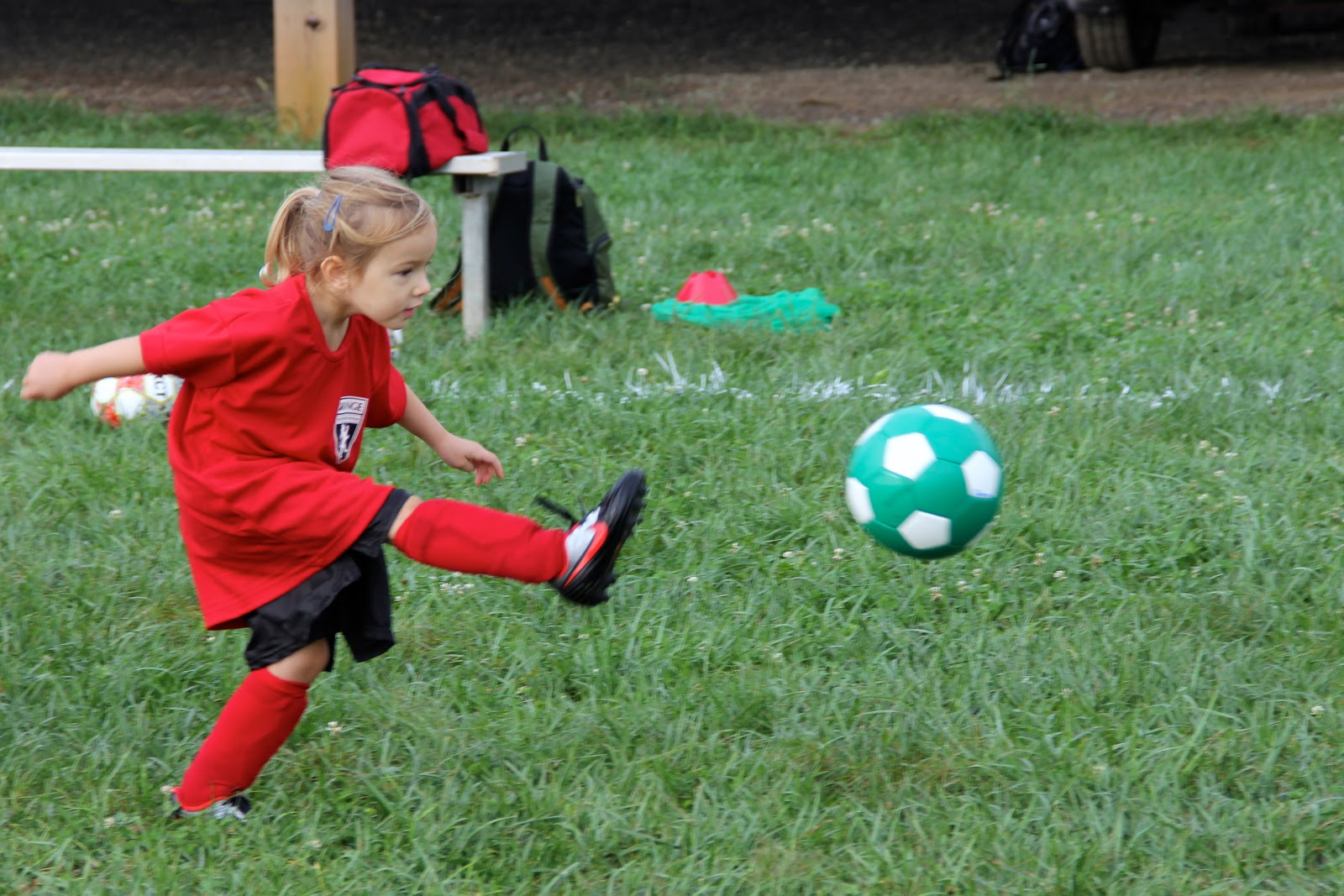 Girl kicking soccer ball