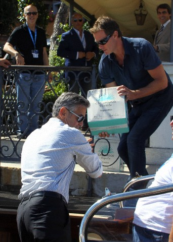 George Clooney and Rande Gerber deliver Casamigos tequila to Venice Corbis-42-50884820