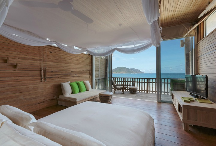Coastal island style bedroom with ocean view