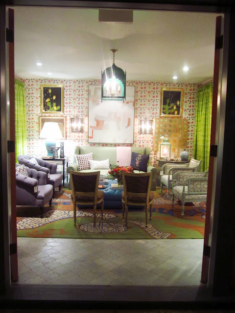 entrance to harbinger showroom in los angeles  with sofas and armchairs arranged around a blue ottoman