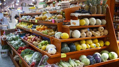 Make The Switch To Plant-Based Living. Picture of fruits and vegetables in a store.