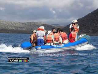 Travel Boldly Galapagos Island - Guide Javier Cadena (right, standing) leads passengers from Guantanamera on a visit to Isla Bartolome.