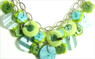 Cool necklace has green and teal fashion buttons layered on silver chain