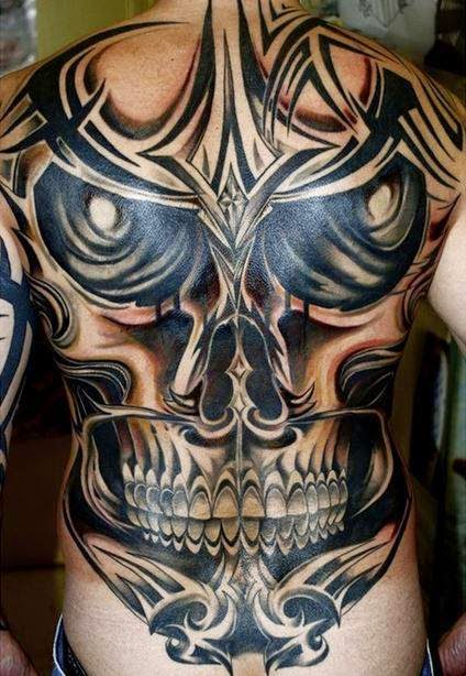 3D tribal skull tattoo on back
