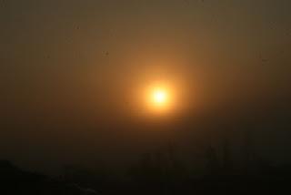 Sun slowly burns through mist