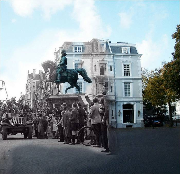 """Allied vehicles drive past Palace Noordeinde, The Hague, (may 1945)"""