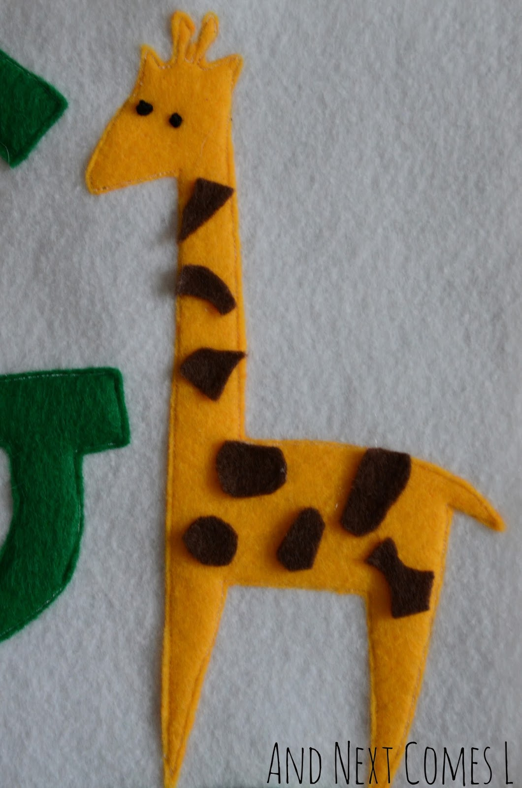 Giraffe on a letter G quiet book page from And Next Comes L