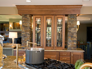 this gourmet kitchen showcases a custom designed display cabinet a