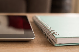 Tablet and notebook - Public domain image sourced from https://pixabay.com/en/notebook-ipad-technology-screen-738794/