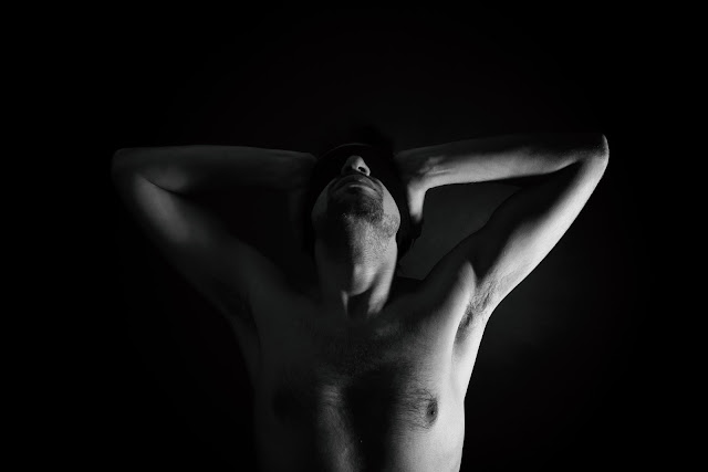 Naked Man with Blindfold on Eyes