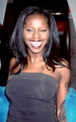 rapper foxy brown in see through