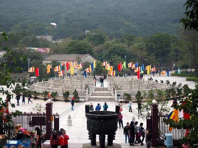 Circular podium and colourful flags in Ngong Ping Piazza, taken from Big Buddha stairs, Ngong Ping, Lantau Island, Hong Kong