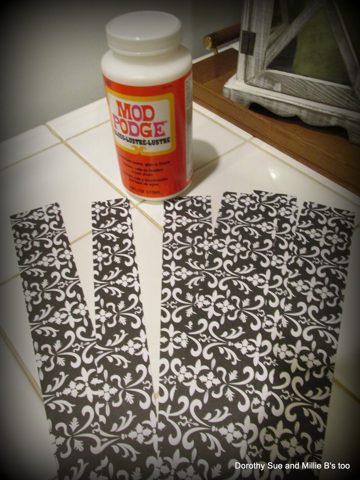 i used a credit card to really get it to adhere before pulling off the clear contact paper black contact paper project