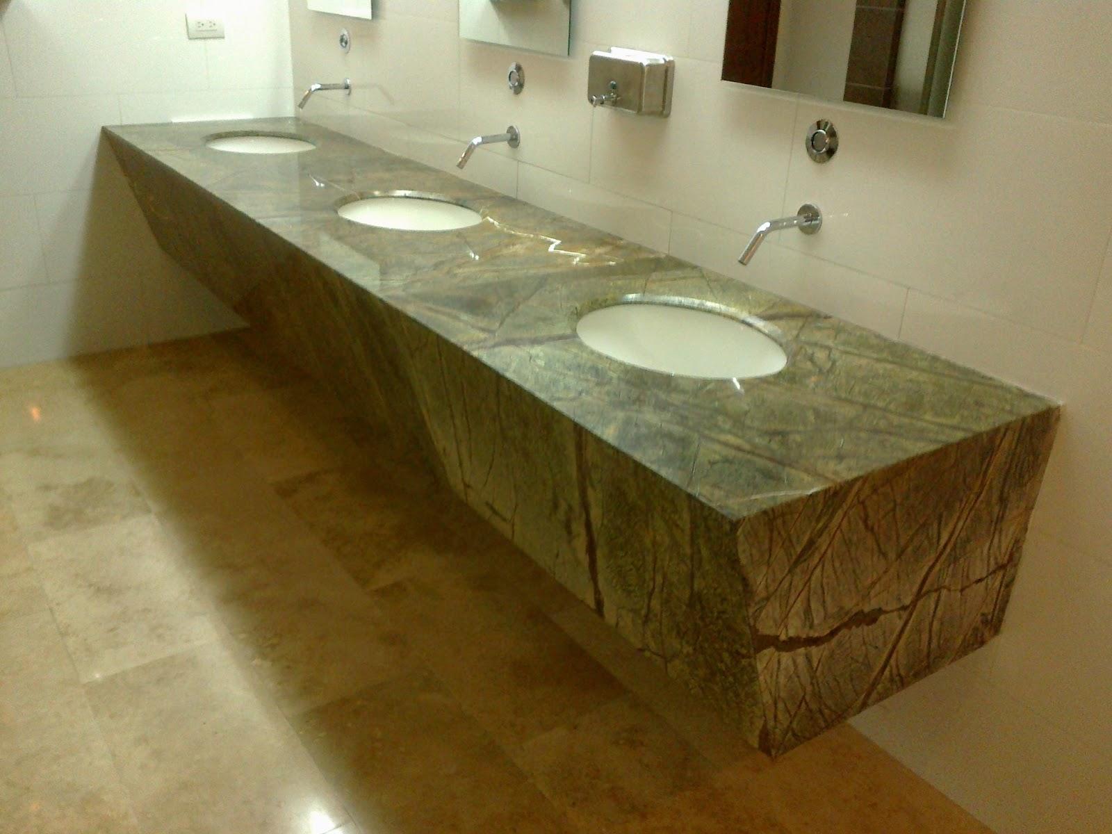 Superficies en poli cuarzo acero y granito industria - Granito y marmol ...
