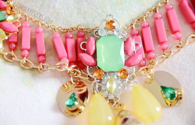 Close-up of the bright pastel beads and jewels on the Armada Pastel Bib necklace, a statement piece from the Bezel Box Mini.