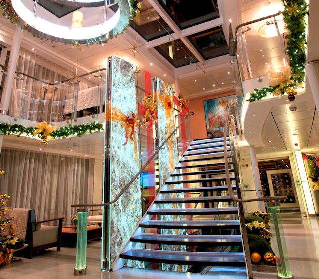 Decked in all its festive finery, the atrium lobby onboard the Viking River Cruises Longships welcomes guests with Christmas cheer! Photo: Property of Viking River Cruises. Unauthorized use is prohibited.