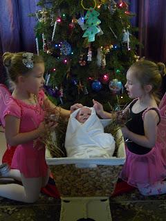 Sugar Plum fairies bringing sugar plums to baby Jesus