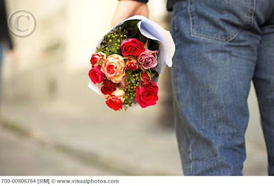 man_holding_flowers_woman_walking_away_nice gay