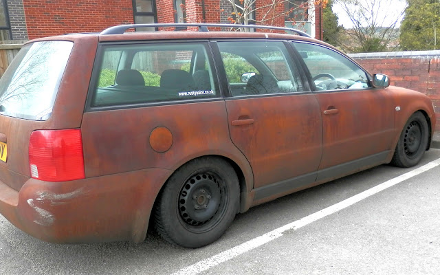 Car painted to look as though it is rusty