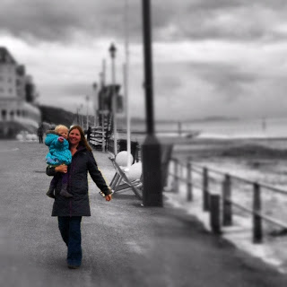 Mummy and Eliza walking along the prom