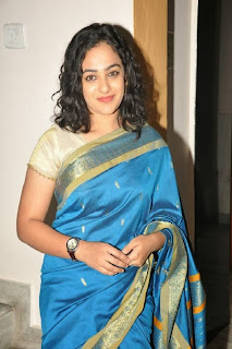 Nihtya Menon Pictures in Saree at Malini 22 Audio Launch