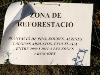 Cartell indicador de la zona de reforestació