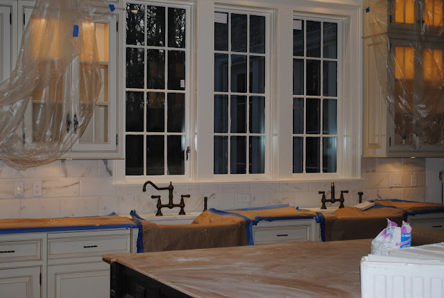 During construction of Enchanted Home Tina's kitchen with two farm sinks and trio of windows