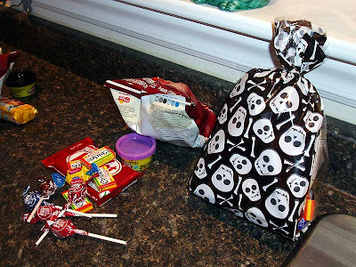 When you know that you are only going to get a dozen kids you can afford to max out the contents of the treat bags.