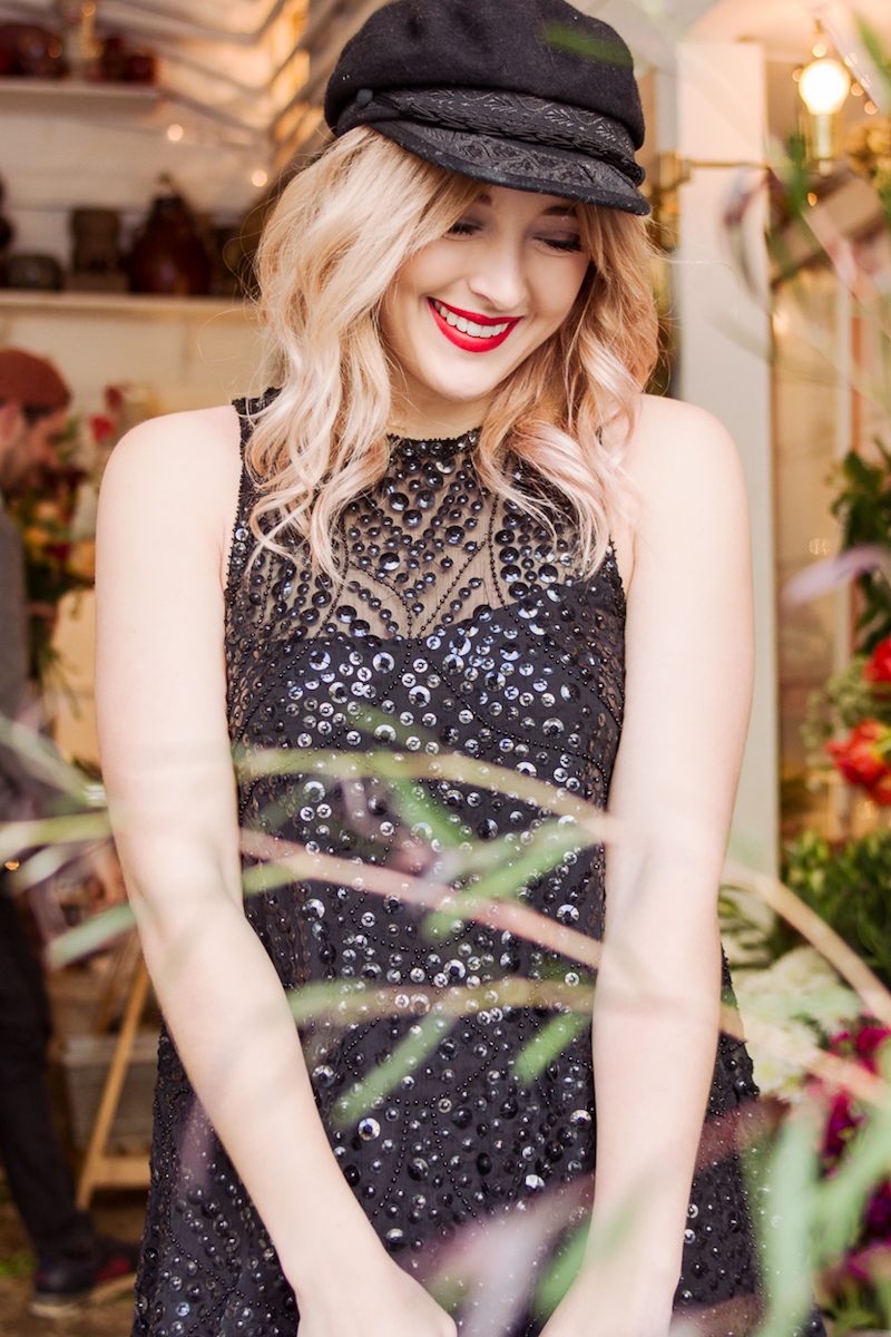 Raga Sequin Sparkle Holiday Dress from Urban Outfitters perfect outfit idea for casual cool NYE or holiday plans styled by Bryn Newman of Stone Fox Style