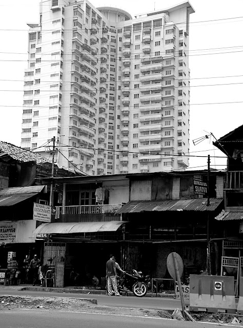 slums and luxury apartment buildings in Jakarta