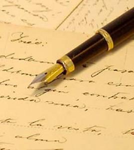 fountain pen lying on beige parchment paper