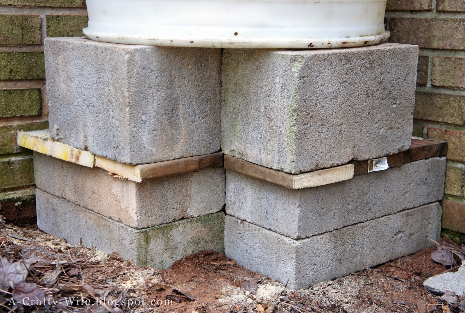 Build platform for rain barrel with cinder blocks | A Crafty Wife