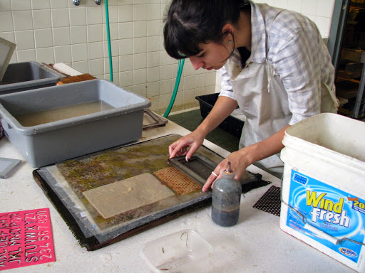 A student makes paper