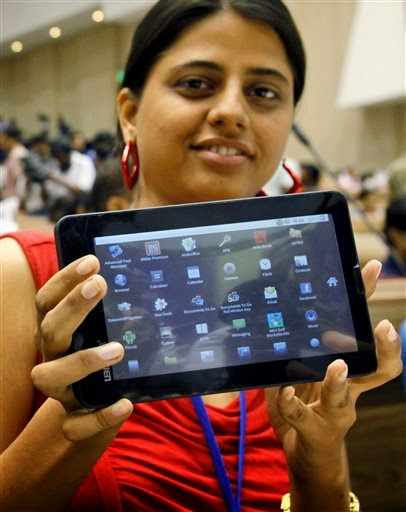 GIRL STUDENT INDIA WITH IPAD AKASH TABLET