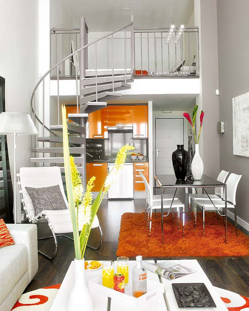 design solutions for small spaces, small space design, studio loft, loft design, loft bed, decorating small spaces, tiny spaces, storage solutions, eclectic, eclectic design, eclectic interiors, orange interior design, orange room, orange apartment, spiral staircase