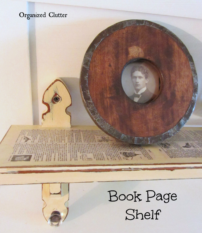 Torn Book Pages on Up-cycled Shelf www.organizedclutterqueen.blogspot.com