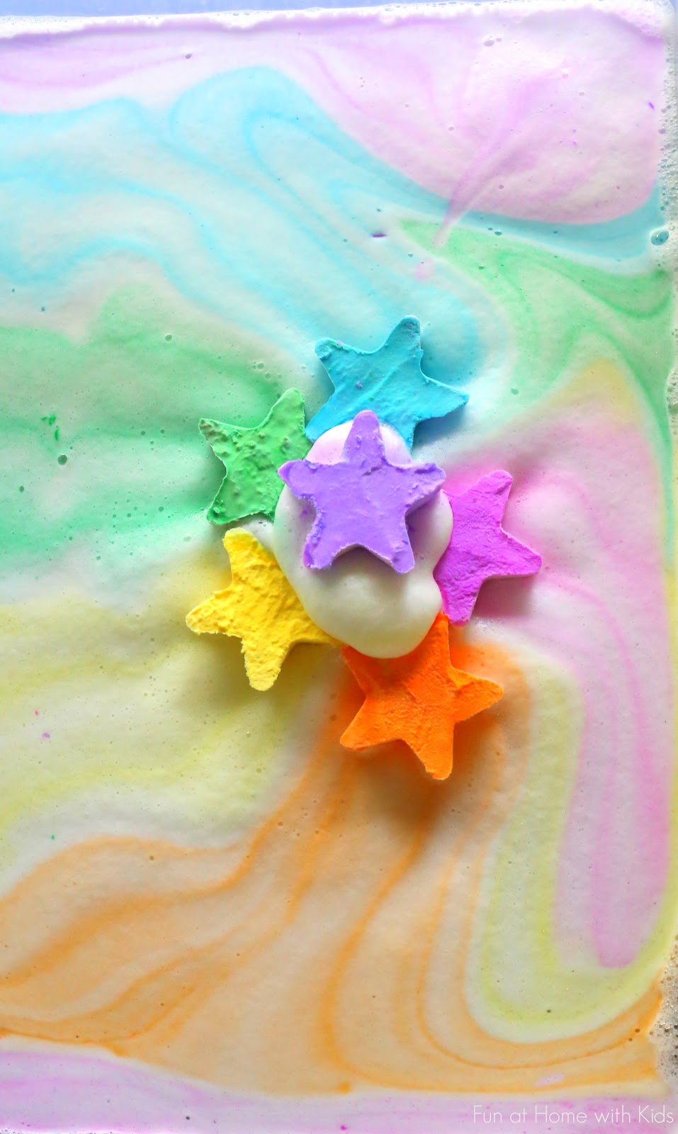 A NEW play recipe:  Magic Foaming Stars.  Add them to your shallow tray and watch as they shoot out rays of colored foam.  Search through the mound of puffy ice cold foam produced to find the treasures once hidden inside.  From Fun at Home with Kids