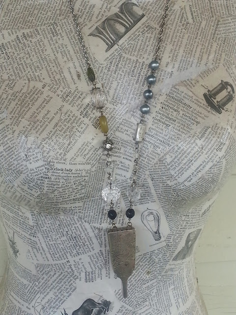 hanging view of necklace made with recycled beads and chain