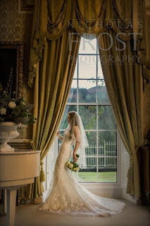 Bride standing at the window of a sumptious Scottish hotel