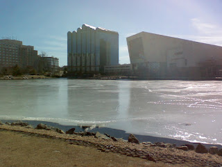 frozen lake by a shopping center