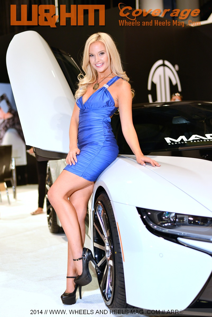 Sema model Lisa Lee Marie for 2Crave Wheels in gorgeous blue minidress by the BMW i8 at 2014 SEMA show
