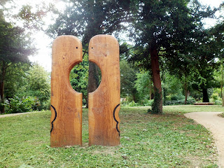 wooden statue with trees viewable