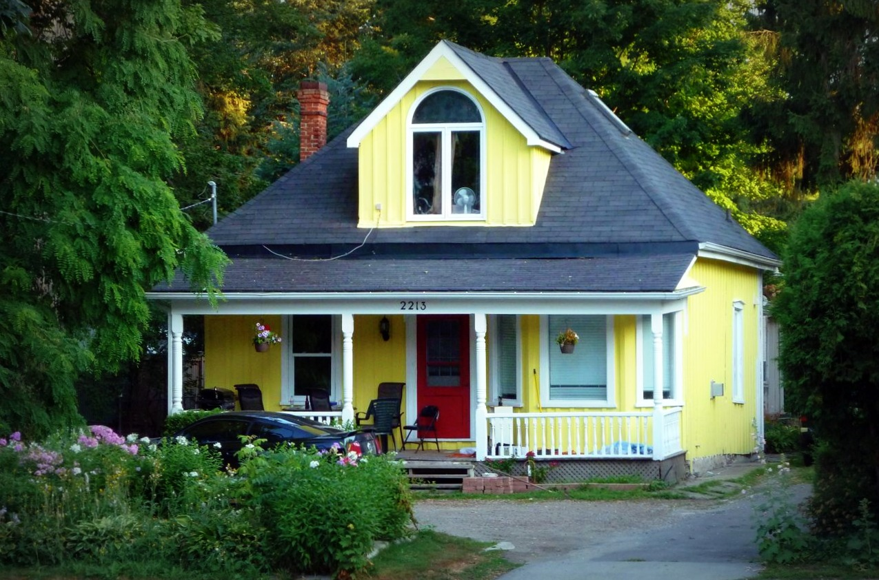 SightLines: two yellow houses with red doors