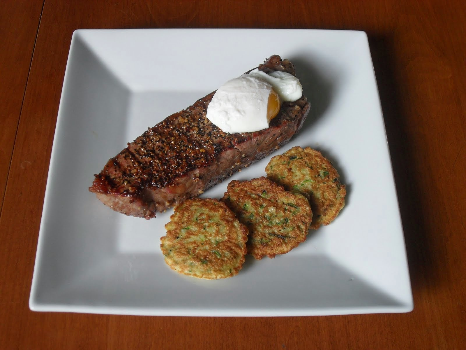 Grilled Steak with A Poached Egg and Zucchini Fritters