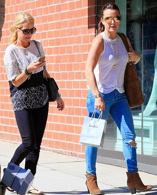 There's no telling what the duo discussed over shopping fun, but Kyle Richards seemed very comfortly in her casual appearance. The 45-year-old dressed for easy to walk in a blue jeans and a cosy white cloth to stock up on groceries at Beverly Hills on Monday, September 22, 2014.