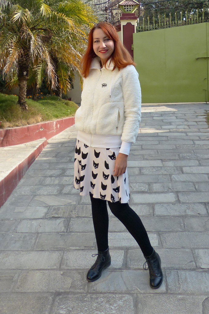 Outfit in black and white with cat print skirt